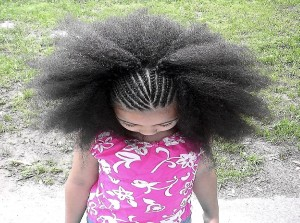 girl in pink with beautiful hair braids 300x223 7 essential tips for natural hair