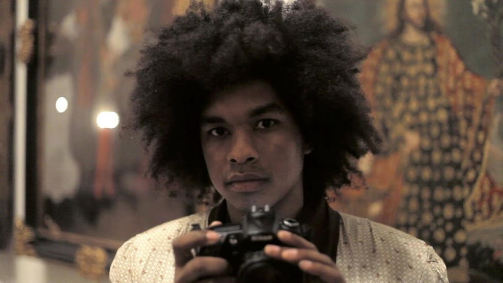 Still of Terence holding Camera